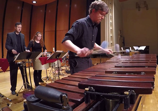 Dr. Brett Jones, left, and student members of the UW-Superior Percussion Ensemble