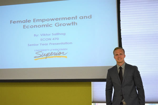 Viktor Salhag, presenting his senior capstone paper on 'Female Empowerment and Economic Growth'