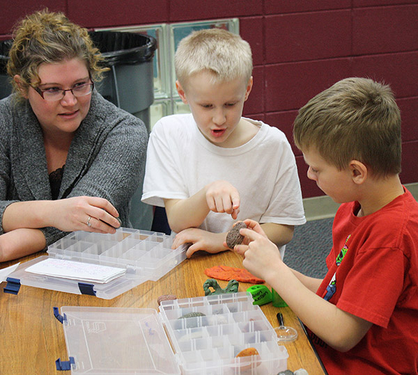 A UW-Superior Geology 110 student works with Great Lakes Elementary students on their rock boxes for an Academic Service-Learning project