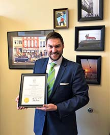 Nathan LaCoursiere with certificate of appointment