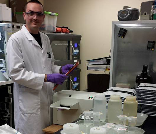 Kevin Nevonin sealing Quanti Trays in the Microbe Lab