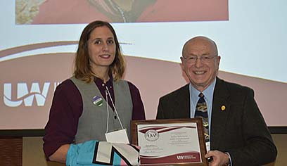 Ray Cross, UW System president, presented Julia Johnson, UWS alum, the P.B. Poorman Award at ceremony in Madison.