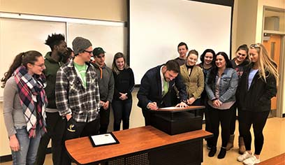 Students in Nathan LaCoursiere's class at UW-Superior helped make his appointment official by executing the oath of office.