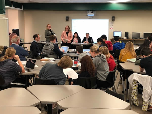 Seniors Reggie Semanko and Melody Maleski education high school Mock Trial team members and their coaches at Mounds View High School on November 29, 2017.