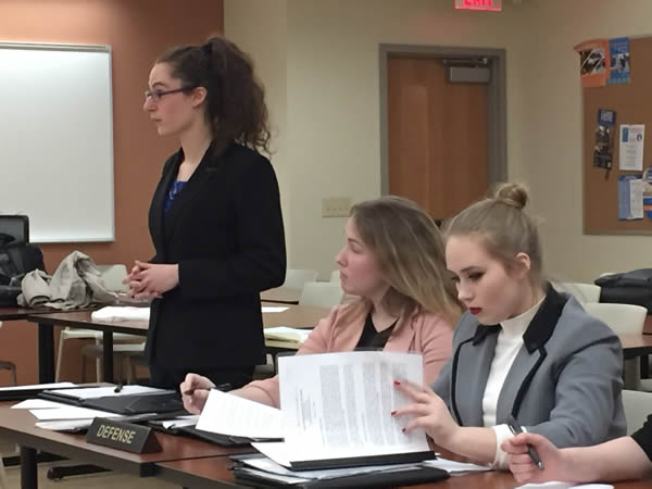 Autumn Bass argues a legal motion with Reggie Semanko and Karlie Mattson at counsel table.