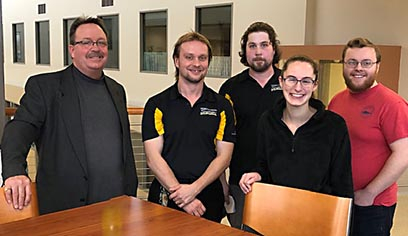 SSC services for education crew and mock trial team work together to prepare UWS courtrooms in Swenson Hall for the annual Superior Durst Mock Trial Invitational. SSC crew members Andrew Mattson and Samuel Kelly are pictured with UW-Superior mock trial team members Autumn Bass, Kenneth Benz and Scott Holmes.