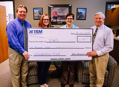 The Institute for Supply Chain Management presented a $1,000 check to professors Daniel Rust and Richard Stewart and Jeanne Thompson of the UW-Superior Foundation.