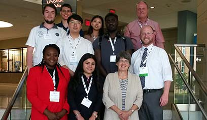 First row L to R: Opeyemi Omiwale; Daniela Leon Vargas; Julie O'Leary, UWS URSCA director; second row: Naum Kuzmanovsky; Jounglag Li; Sam Waylee; Ray French, WiSys; third row: Jerad DeVries, UWS math lecturer; Dayeong Lim; Sergei Bezroukov, UWS math professor.