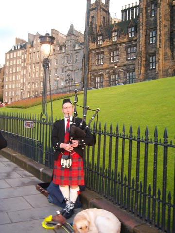 A piper and his friend add a little local color to Edinburgh.
