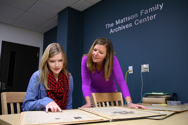 UW-Superior student Jami Konkler and faculty member Jamie White-Farnham reviewing research for a SURF project